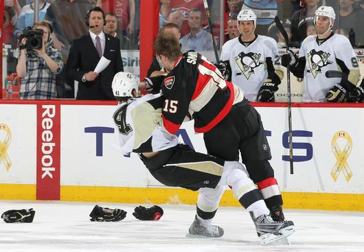 Pittsburgh Penguins' Olli Maatta (3) and Nick Bonino, top, tngle with